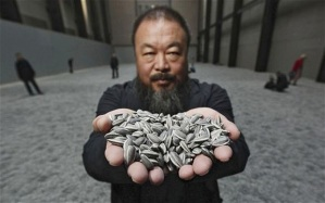 Ai WeiWei with his installation of sunflower seeds representing all the forgotten individuals in China.